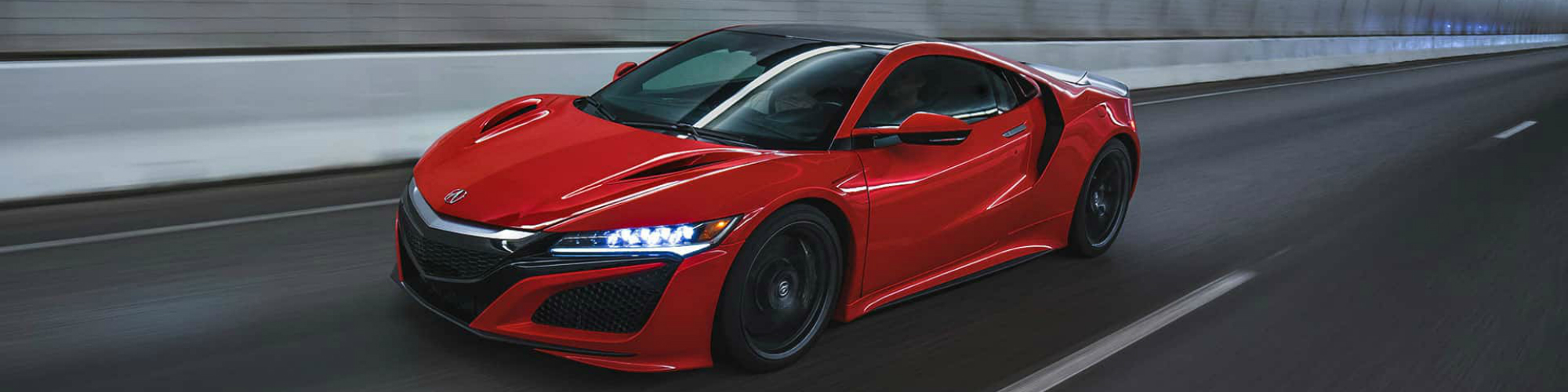 When it debuted at the 1989 Chicago Auto Show, Honda's latest car, the NSX (marketed in North America as the Acura NSX), took the world of exotic cars by storm. It was the first mass-produced car to feature an all-aluminum body and utilized advanced aerodynamics that gave the car a look and style that more closely resembled an F-16 fighter jet. The fan favorite mid-engine sports car was the marquee piece in Honda's lineup for 15 years before going out of production in 2005. Thankfully, fans can rejoice as the new NSX is here and it looks even better than ever.
