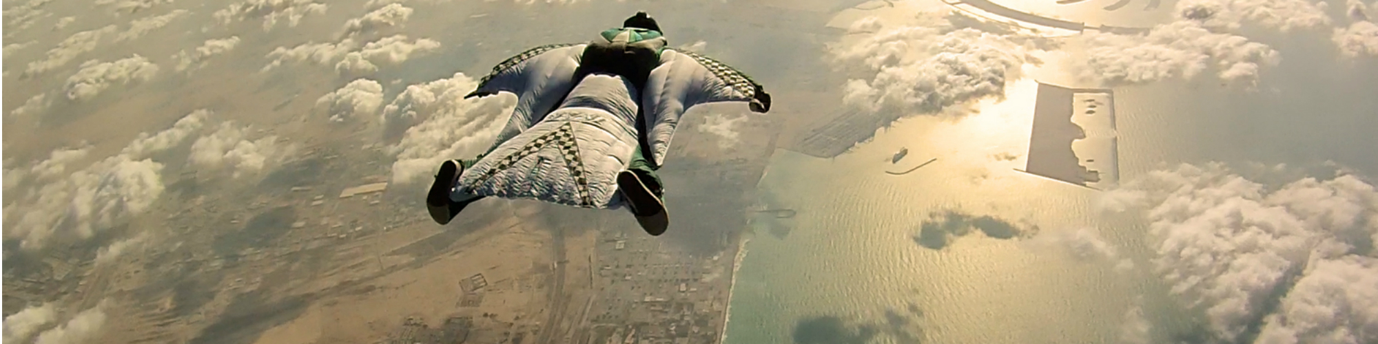 "Today, ""Point Break"" is most well-known for its visually stunning action sequences featuring intense surfing scenes and breathtaking skydiving maneuvers and is now being remade for a new generation. Where the original 1991 film showcased skydiving as the pinnacle of extreme, the updated remake is taking it one step further with a wingsuit stunt sequence for the ages."