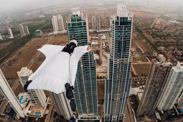 Roberta Mancino Flies between Two Panama Skyscrapers