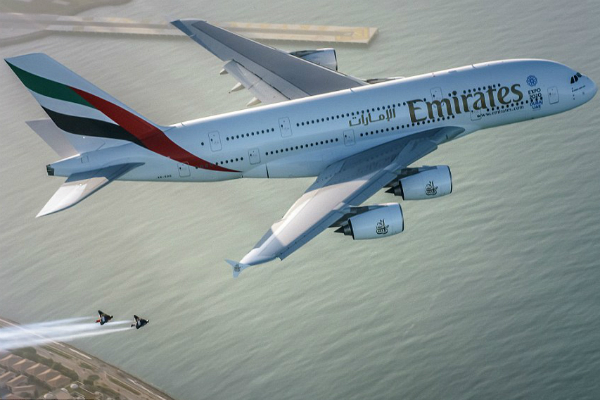 Jetman Dubai Take Flight Alongside Emirates Airplane