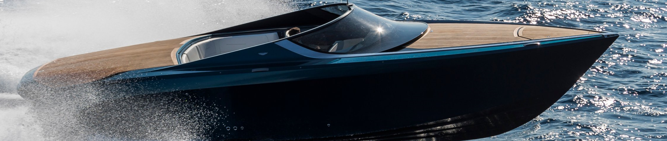Just when you think that you have seen it all, Aston Martin has made the leap into luxury watercraft with the AM37. The name reflects the length of the vessel that is specifically designed to cater to those that appreciate the Aston Martin brand and share a love for watercraft. AM37 is a wooden decked powerboat utilizing twin Mercury 520 hp V8 engines for a combined power output of 1040 hp.