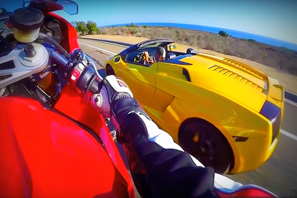 BMW Biker Pulls Stunts Next to Lamborghini Gallardo