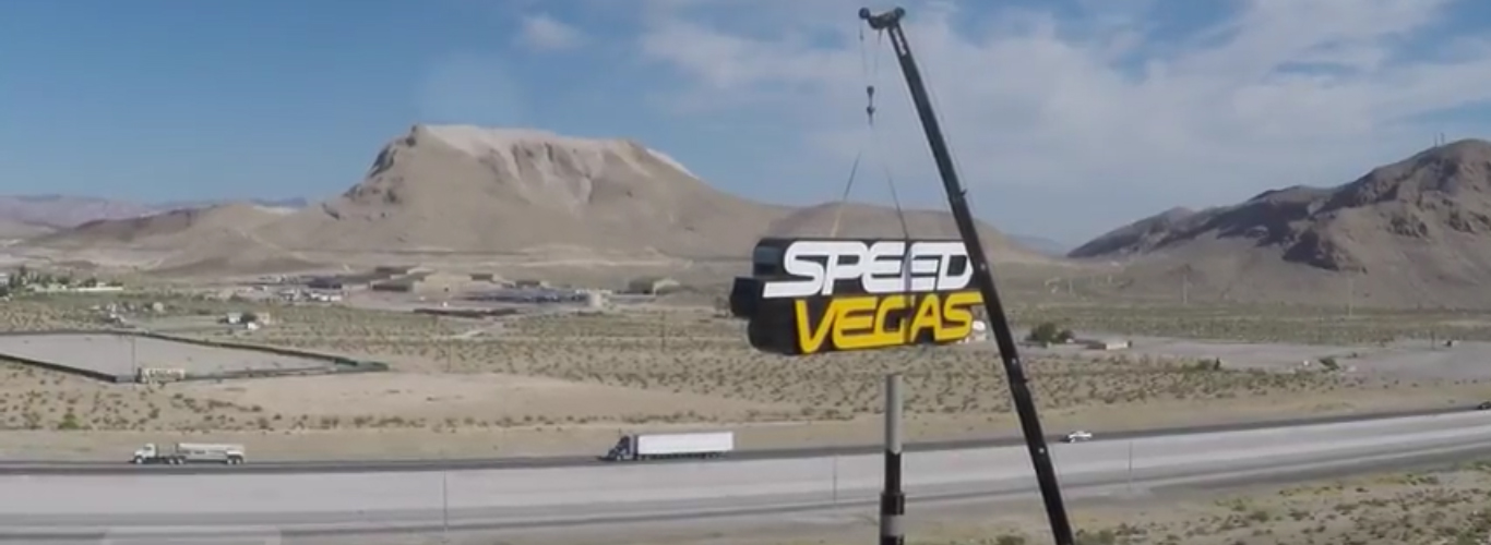 """Construction crews have completed installation of the massive, 100-foot high and 50-foot wide SPEEDVEGAS sign that will be fully lit for the first time at dusk on Friday, June 10th. This massive undertaking included 1,800 man-hours of design, tooling and fabrication resulting in the creation of one of the largest signs of its kind. Illuminated with 19,200 programmable LEDs and standing 10-stories tall, the SPEEDVEGAS sign will be the first sign that all visitors traveling north on Interstate 15 will see as they approach city limits. Having a sign of this height and width was needed in order to """"Attract fast-moving, incoming and outgoing drivers from miles away,"""" according to Darrell Stock, general manager of Patrick's Signs. """"Due to the sheer size, it is rare to find a commercial sign like this anywhere in the world. To put its size in perspective, the SPEEDVEGAS' sign is more than twice the average commercial sign size."""""""