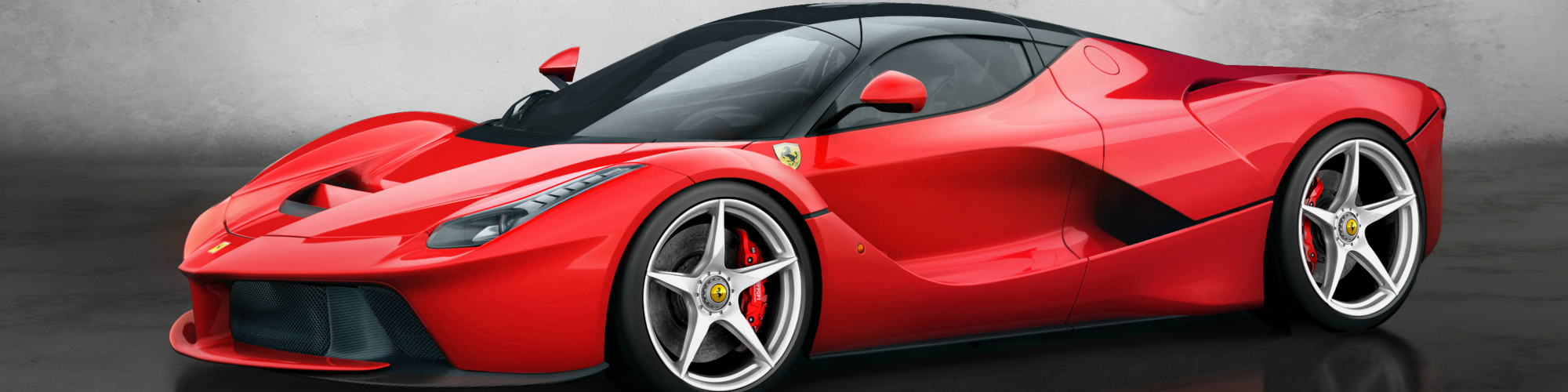 ​Ferrari's LaFerrari carries on the legacy of the Enzo Ferrari that came before it. It shares the same wheelbase as the Enzo and like its predecessor, is generally considered to be a larger car. The LaFerrari sits longer and wider than most other cars in its class, such as the McLaren P1 and the Porsche 918 and is actually taller than both of them as well as the Enzo Ferrari. Who then would complain that this exotic hybrid supercar wasn't big enough for them? That person would be none other than The Rock, and we aren't going to argue with him.