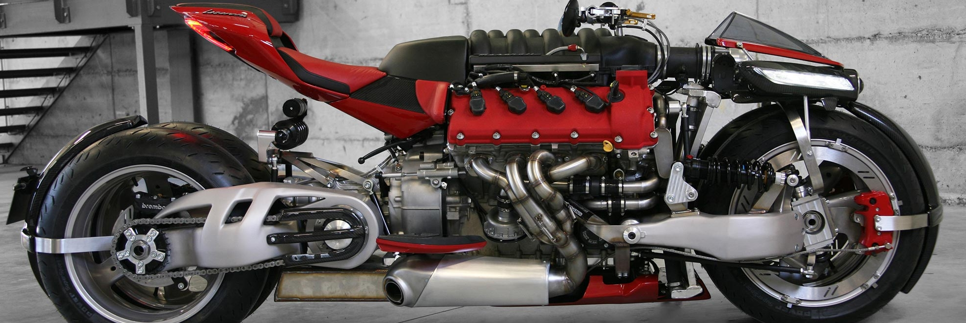 Not since the Dodge Tomahawk have we seen such a massive powerplant placed into a motorcycle configuration. This latest excursion into insanity was designed by Ludovic Lazareth who unveiled his superbike at the 2016 Geneva Auto Show. Since then, the Maserati powered motor cycle has been keeping a low profile until video recently surfaced of the 4.7-liter V8 superbike in action.