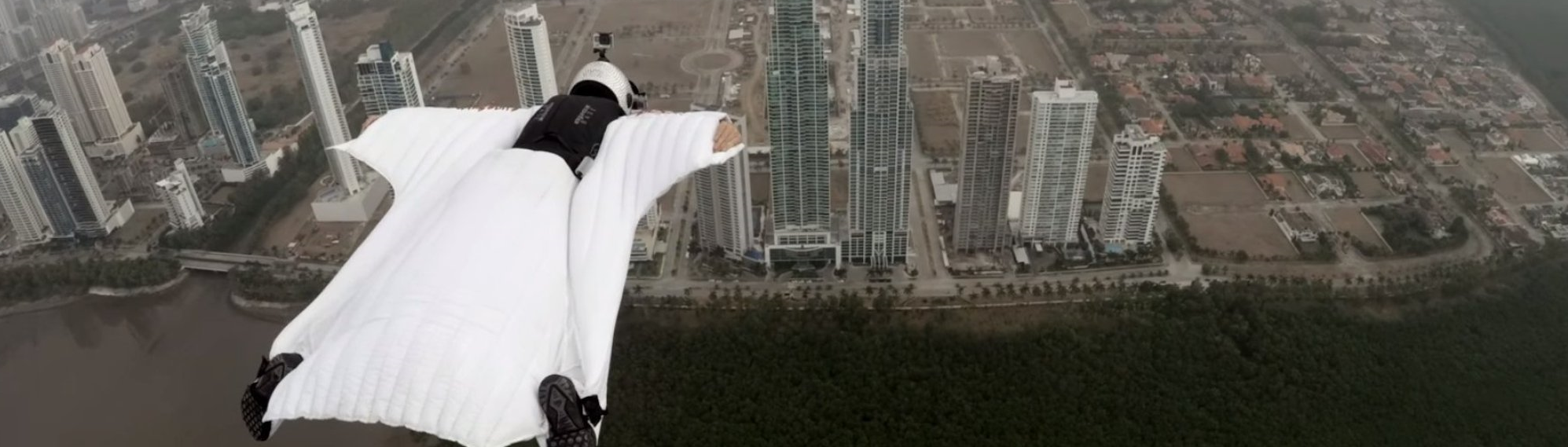 Italian model and daredevil Roberta Mancino is gaining quite the reputation in the world of extreme sports. Between the time that she spends swimming with sharks and skydiving around the world, she is beginning to create a rather large viral buzz. Her latest aerial stunt consists of flying in a wingsuit between two skyscrapers in Panama that was filmed as a promotion for GoPro.